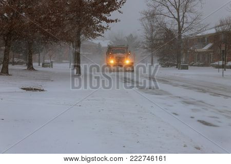 Snowplow removing snow from city road Tractor Snow clearing