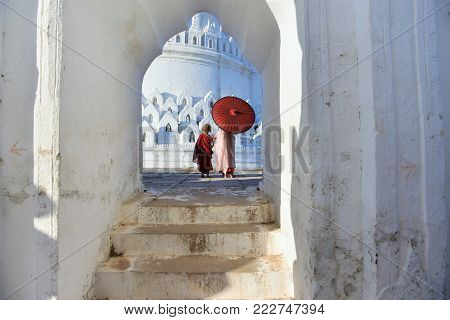 monks and nuns with traditional clothing in white temple myanmar