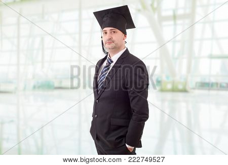 Proud male college professor standing at school
