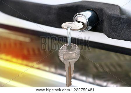 Close Up Of Key At Car Door Or Truck Door. Key Car Insert To Key Door With Copy Space.