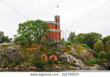 Kastellet with Swedish flag on Kastellholmen island in Stockholm, Sweden.