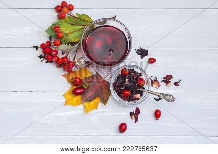 Still Life Cup Of Fruit Tea On Autumn Leaves And Vintage Wood Background.