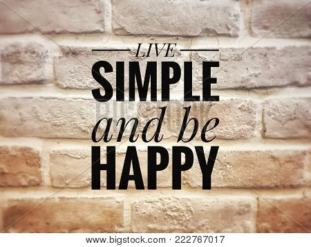 Motivational and inspirational quotes - Live simple and be happy. With blurred styled background.