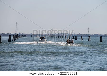 Venice, Italy - August 13, 2016: Motor boats with tourists in the Adriatic Sea