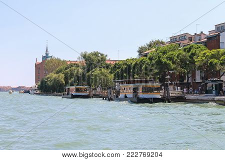 Venice, Italy - August 13, 2016: Tourists near pier on the Adriatic Sea