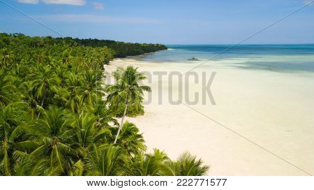 Aerial shot of the white and deserted tropical Ohoidertawun beach, Kei Kecil island, Maluku, Indonesia