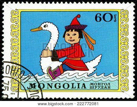 Ukraine - circa 2018: A postage stamp printed in Mongolia show Boy riding swan. Series: International Childrens Day. Circa 1975.