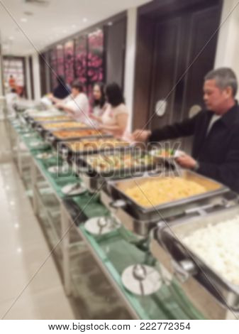 Blurred buffet party with people at hotel