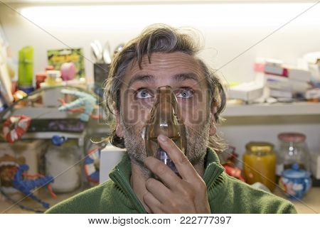 Medical Inhalation Man With Mask On His Face. Nebulizer Device