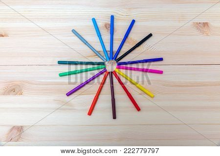 colored felt-tip pens on a wooden table
