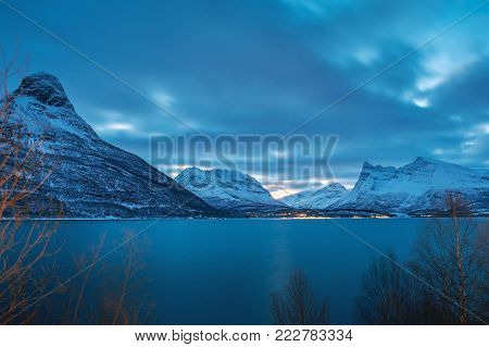 Blue hour lanscape before polar night in the village Lyngseidet on the north of Norway. Landscape of Lyngenfjord in winter.