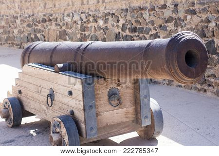 Ancient Canon Used In Wars As Weapon. Heavy And Strong Weapon Carried By Strong Military Forces, Old