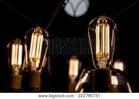 Decorative antique edison style light bulbs are in fact contamplorary LED light bulds made to look like old school. Creating old style look and saving energy