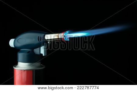 manual gas burner on a black background