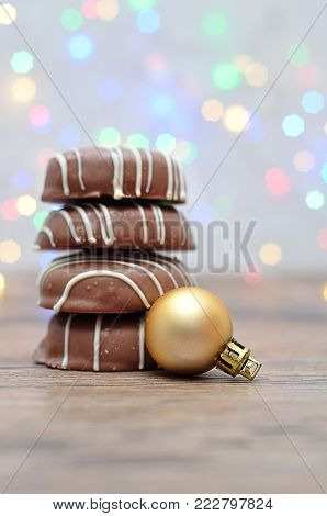 A stack of chocolate covered biscuits and a golden babble