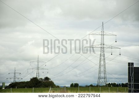 View landscape and agricultural field with Electricity voltage post or Utility pole in countryside of Austria