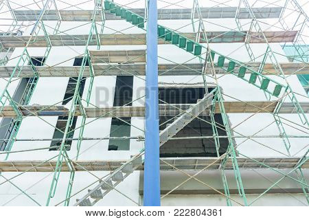 Scaffolding used as the temporary structure to support platform, form work and structure at the construction site. Also used it as a walking platform for workers. poster