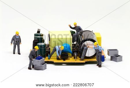 Workers repair computer detail. Miniature worker figurine and micro chip. Men at work macro photo. Computer repair banner template. Fixing electronic hardware. Computer industry. Semiconductor closeup