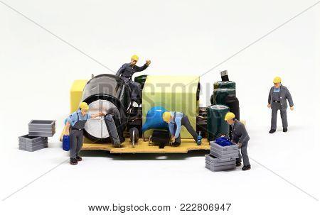 Workers repair computer microchip. Miniature worker figurine. Men at work macro photo. Computer repair banner template. Fixing electronic hardware. Computer industry work process. Building machinery