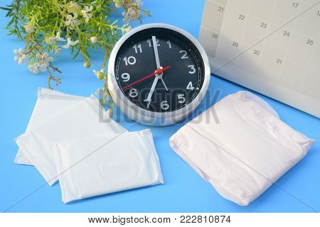 Sanitary pads and absorbent sheets on a blue background