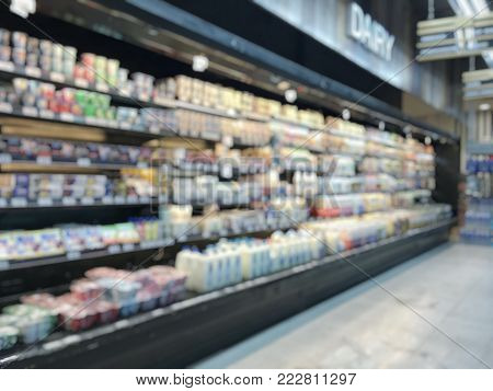 Blur background supermarket place with dairy products food and beverage on refrigerator shelves