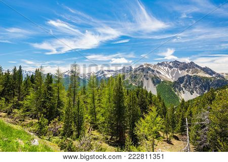 High altitude landscape idyllic uncontaminated environment. Summer adventures and exploration on the Italian French Alps. Expansive view from above, clear blue sky.
