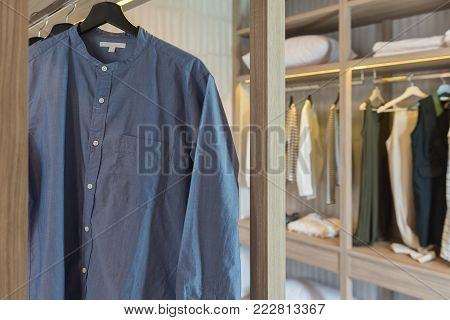 Clothes Hanging On Rail In Modern Wardrobe