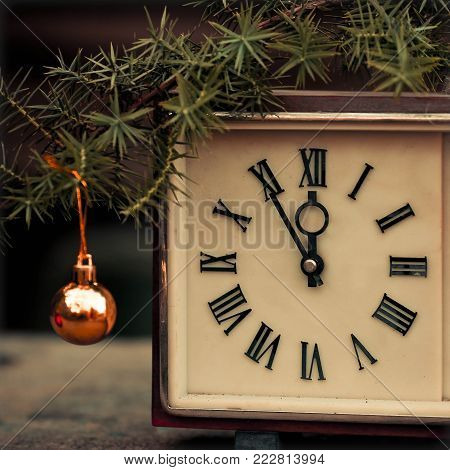 Old hours and Christmas toy. New Year's concept