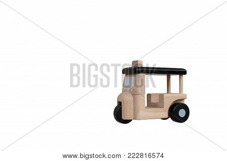 Small model wooden three wheeler transporation in Asia or called Tuk Tuk in Thailand on isolated white background with clipping path
