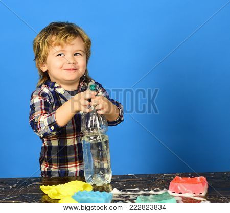 Kid Holds Spray And Spraying Water Out Of Spray Bottle.