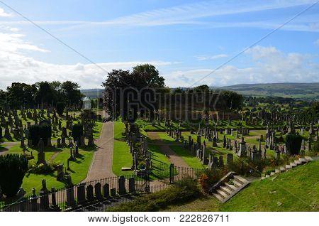 Sun rays shinning over a scottish cemetery