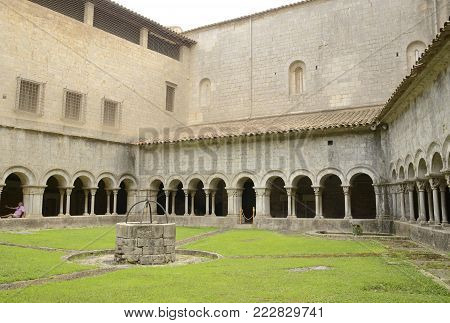 GIRONA, SPAIN - JULY 24, 2017: Water well in the patio of  cathedral of Girona,  Catalonia, northeastern Spain.