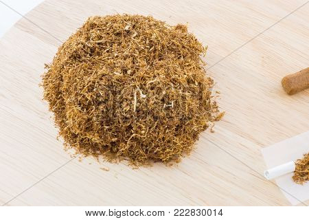 Tobacco and drugs on a wooden board