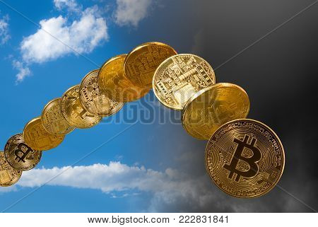 Bitcoin coins rising and falling from the sky to illustrate the falling price of the cybercurrency