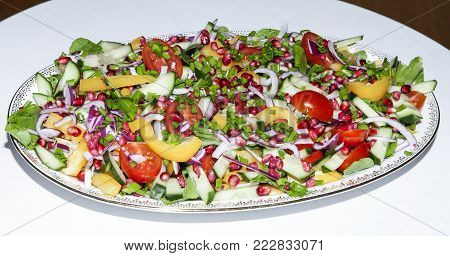 Organic salad on a plate. Different vegetables in colorful combination.