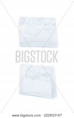 Handmade semi-transparent bar of soap isolated over the white background, set of two different foreshortenings