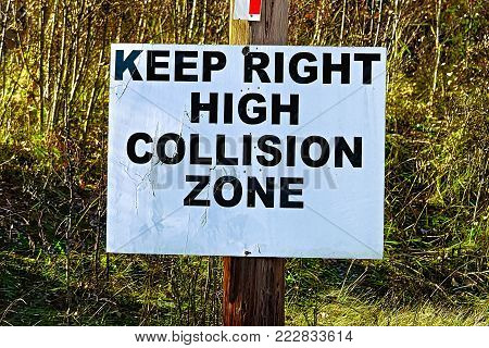 A Keep Right High Collision Zone sign.