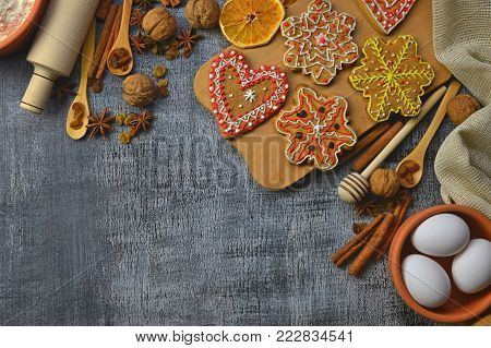 Baking background. Ingredients for cooking christmas baking on dark wood background. Natural Ingredients and Spices. Food background. Top view with copy space. Homemade baking. Gingerbreads with spices.