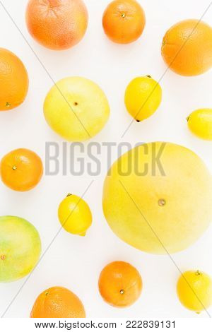 Fruits made of lemon, orange, grapefruit, sweetie and pomelo isolated on white background. Flat lay, top view.
