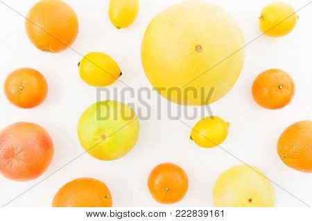 Fruit's background. Citrus fruits - lemon, orange, grapefruit, sweetie and pomelo isolated on white background. Flat lay, top view.