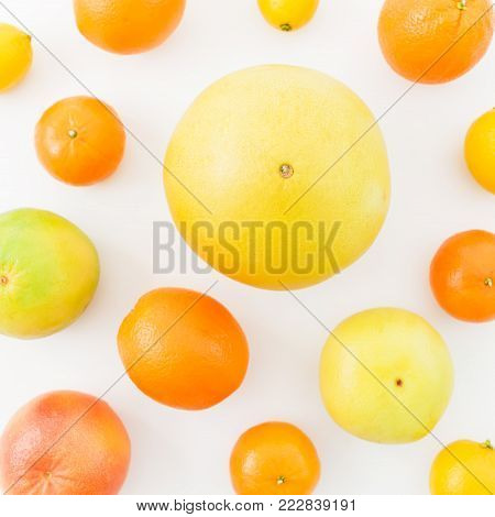 Fruits pattern of lemon, orange, grapefruit, sweetie and pomelo isolated on white background. Flat lay, top view. Fruit's background
