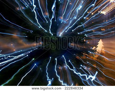 Zoomed Christmas tree. Lodz, Poland - December 26, 2017 An abstract image of a Christmas tree made by changing the focal length of a camera lens.