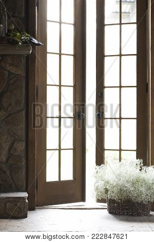 French door entrance in morning light coming through