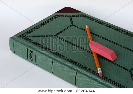 Closed ledger with pencil and eraser