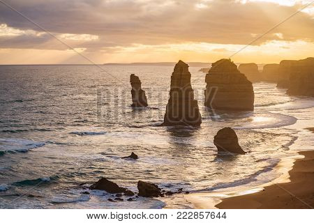 The Twelve Apostles rock the iconic natural landmark of the Great Ocean Road of Australia during the sunset.