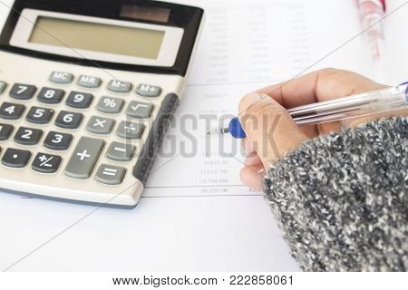 report financial statement yearly balance sheet with hand of woman working in business at office desk
