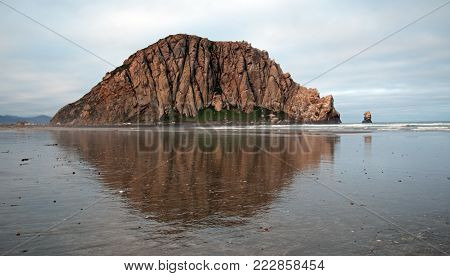Morro Bay Rock At Sunrise at Morro Bay State Park popular vacation / camping spot on the Central California Coast USA