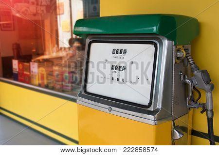 Old Retro Vintage Oil Pump Station Or Oil Dispenser In Petrol Station. Close Up Of Vintage Old Stati