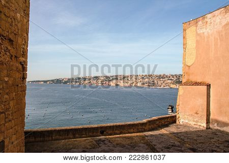 the port of Naples framed by the old wall of Castel dell'Ovo, Naples, Italy