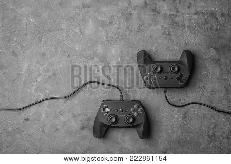Video game controllers on grey background